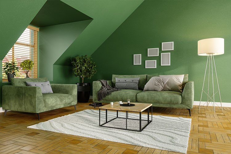 a living room with green walls