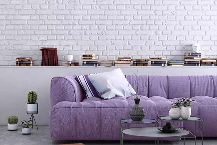 a purple couch with a table and a coffee table