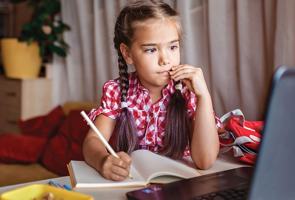 a girl sitting at a desk