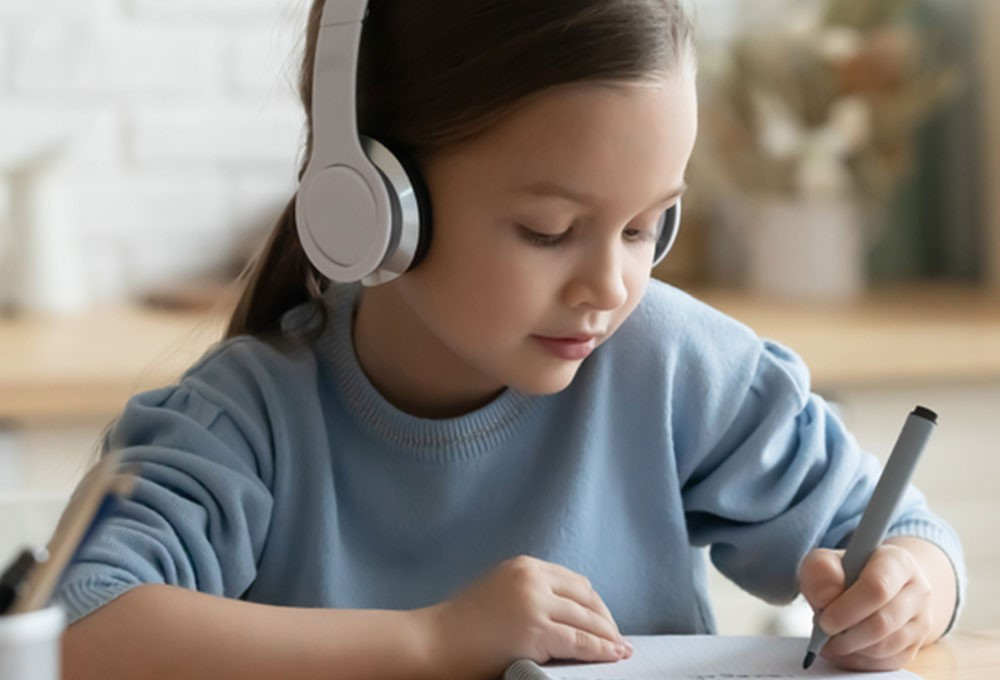 a young girl wearing headphones