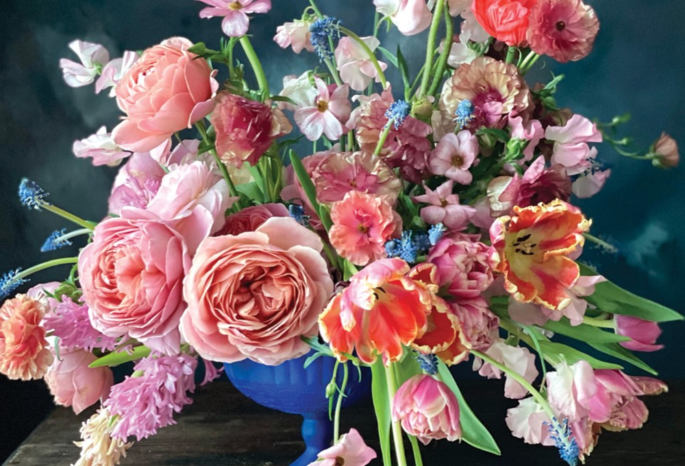 a bouquet of pink and white flowers