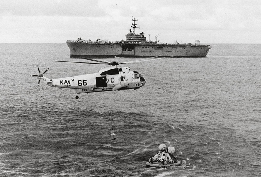 a helicopter flying over a sea