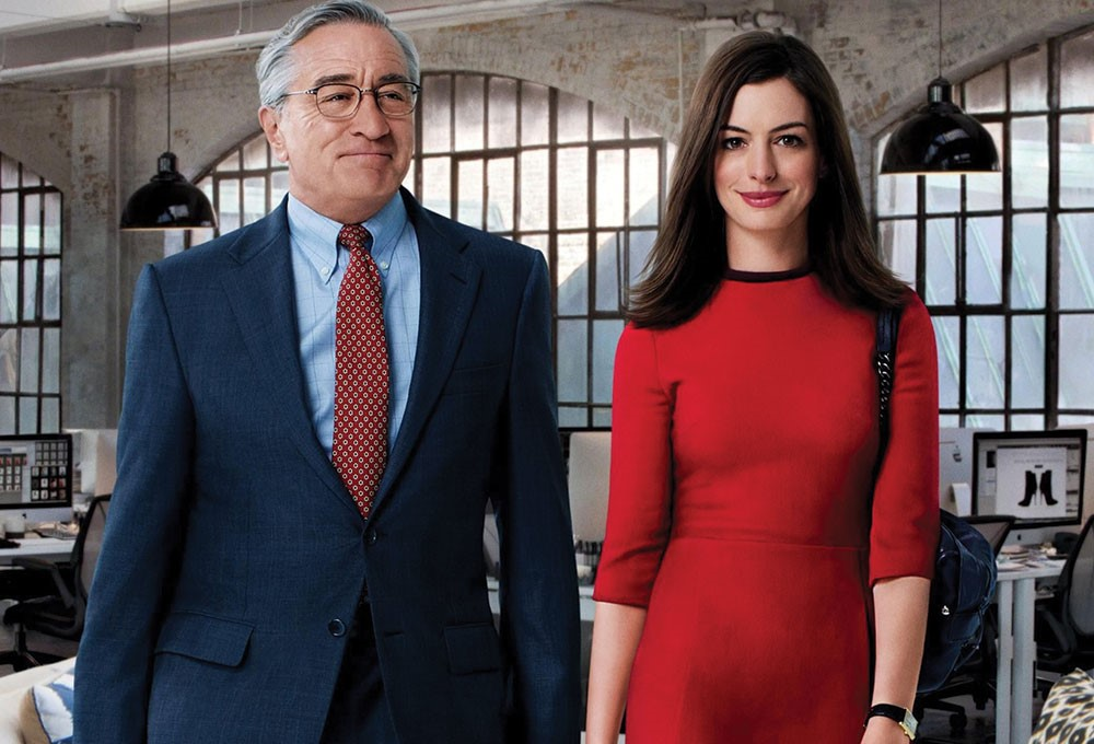 Robert De Niro, Anne Hathaway standing next to each other in a room