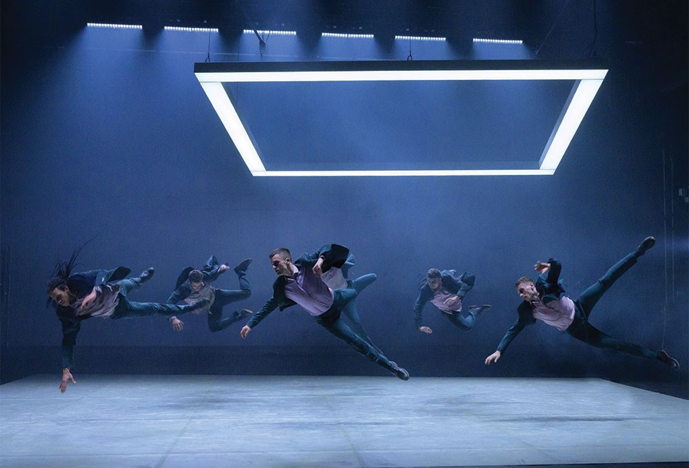 a group of people dancing on a stage