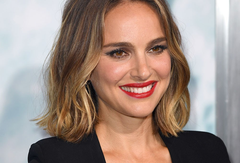 Natalie Portman with long hair smiling
