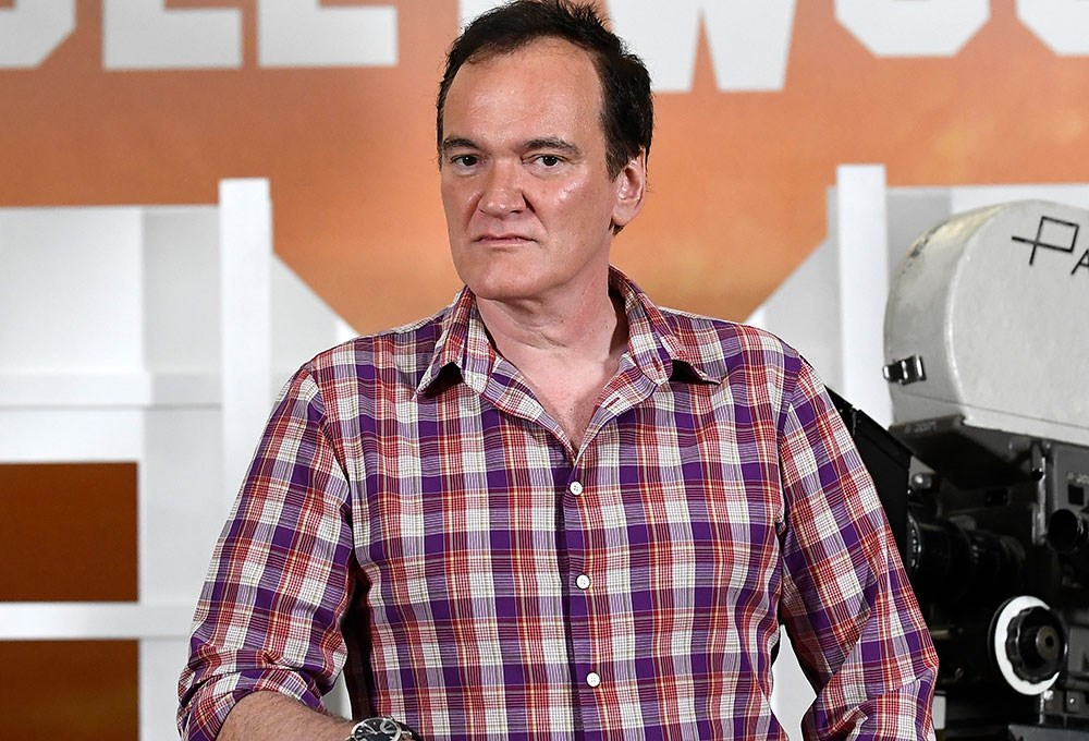 Quentin Tarantino standing in front of a machine