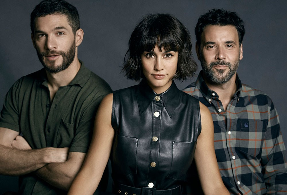 Michel Noher, Megan Montaner, Miquel Fernández are posing for a picture