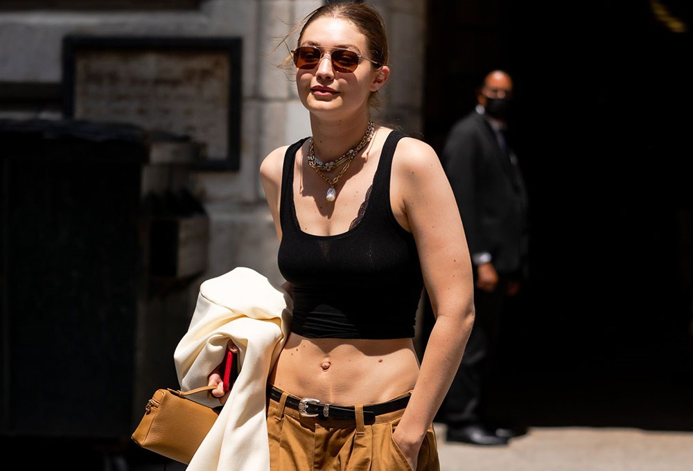 a woman wearing a black top and sunglasses