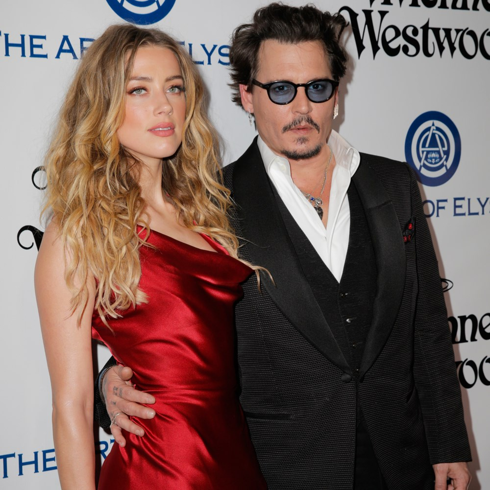 Johnny Depp, Amber Heard are posing for a picture