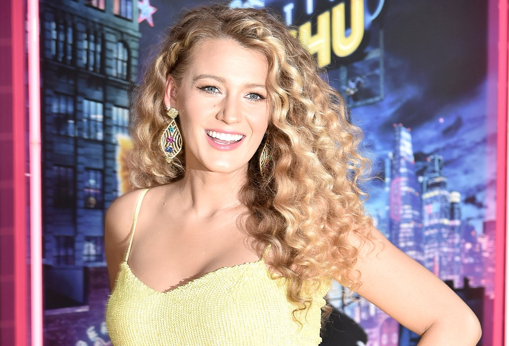 Blake Lively with long hair smiling