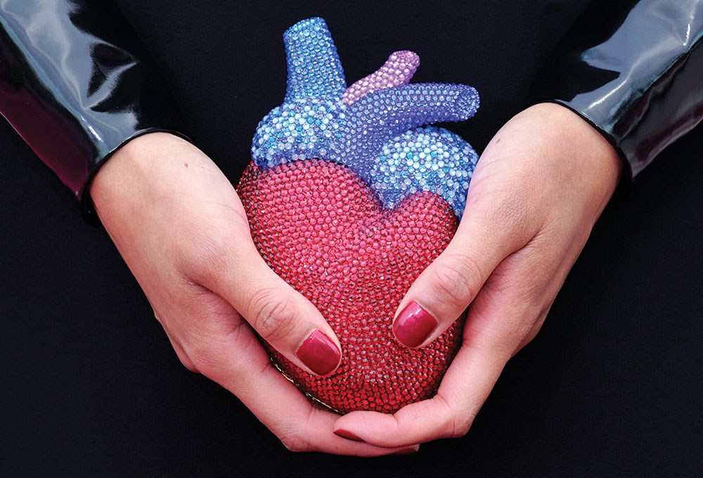 a person holding a ball