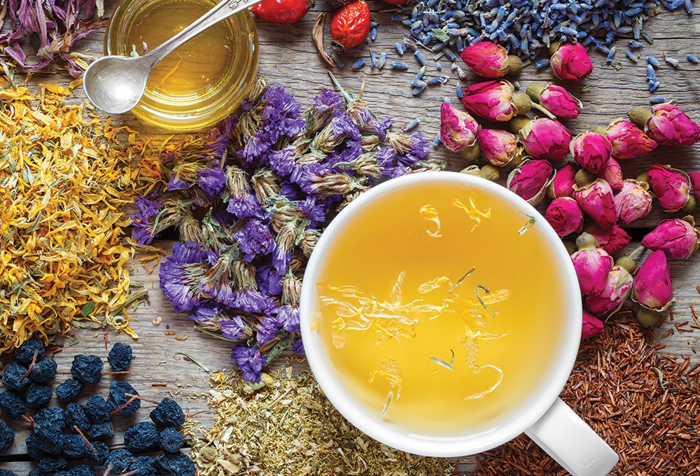 a cup of tea with colorful flowers