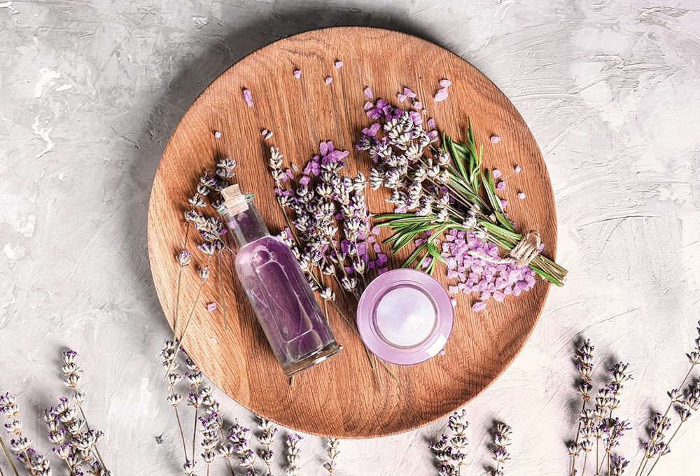 a wooden board with flowers and a cup of coffee