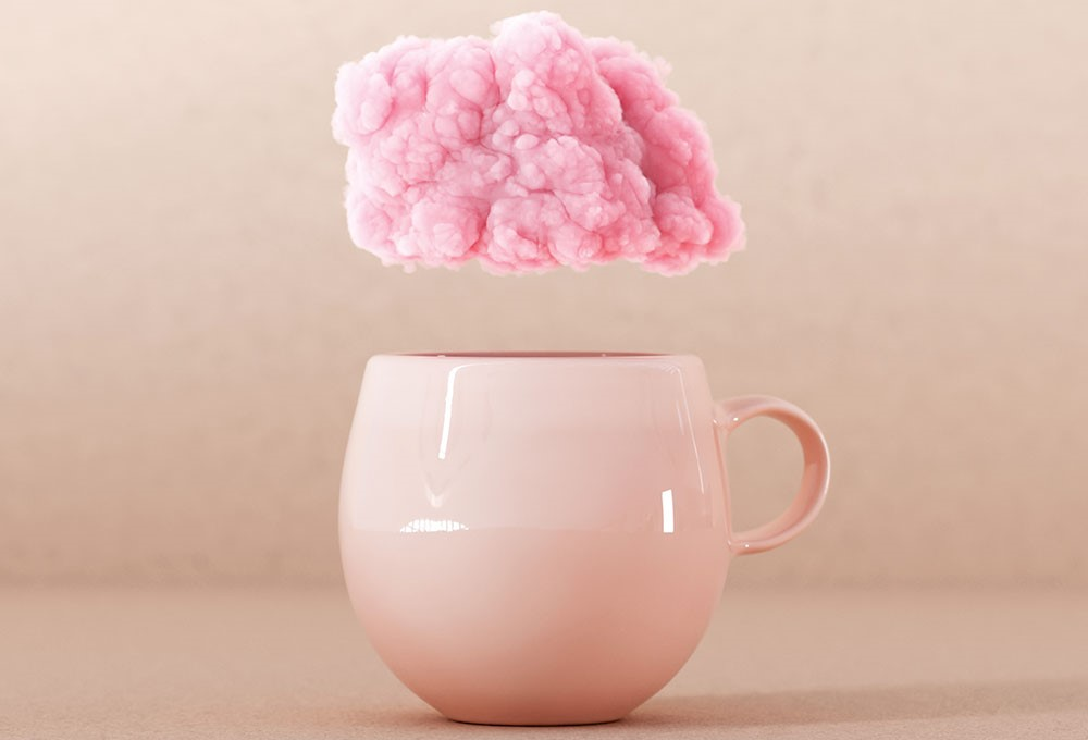 a cup with a flower on it