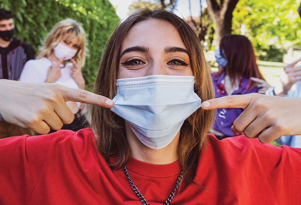 a person with a mask on the face