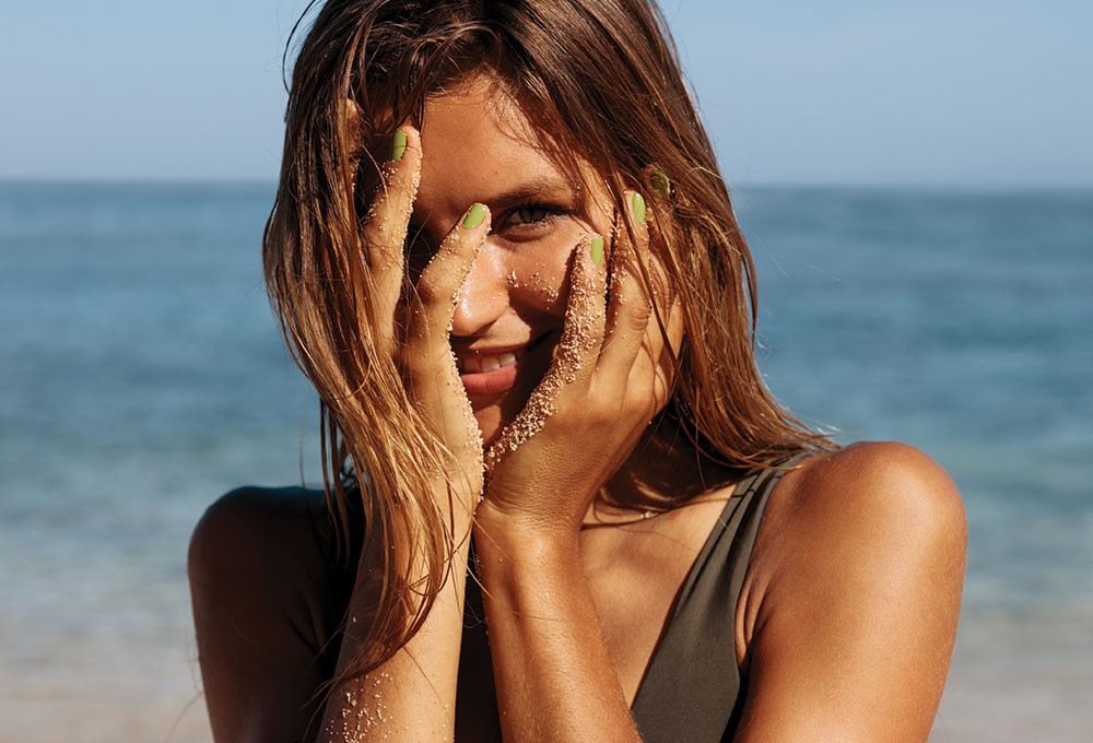 a woman with her hands on her face