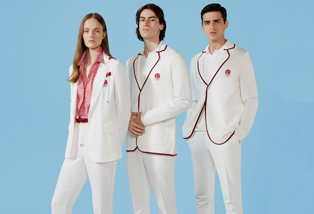 a group of people wearing white outfits