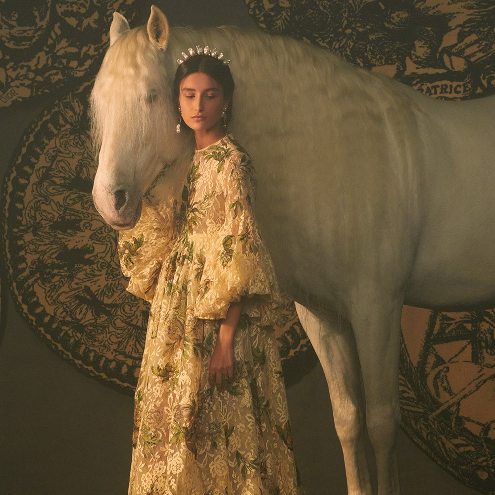 a person posing with a horse