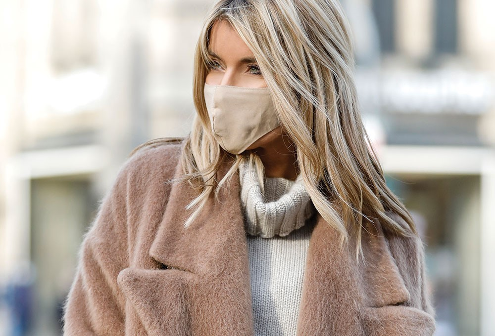 a person with a scarf around the face