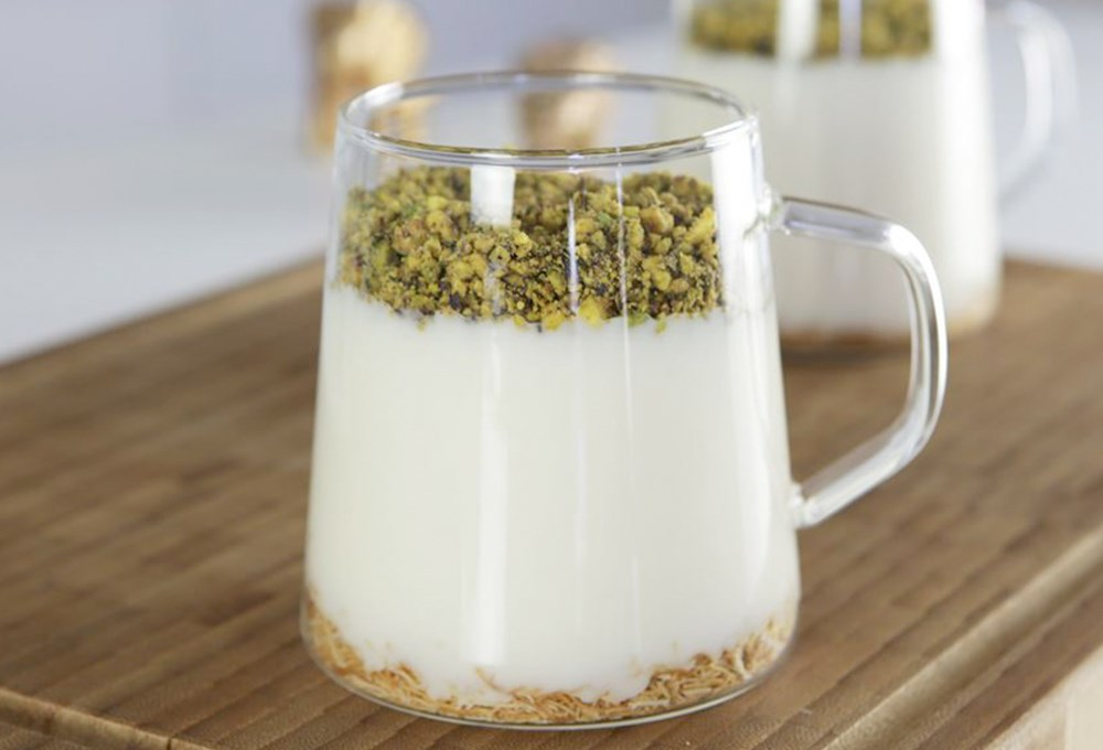 a glass mug with a white substance in it