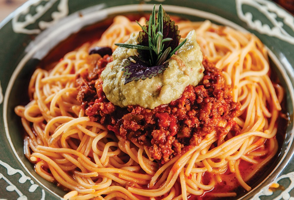 a plate of spaghetti with sauce