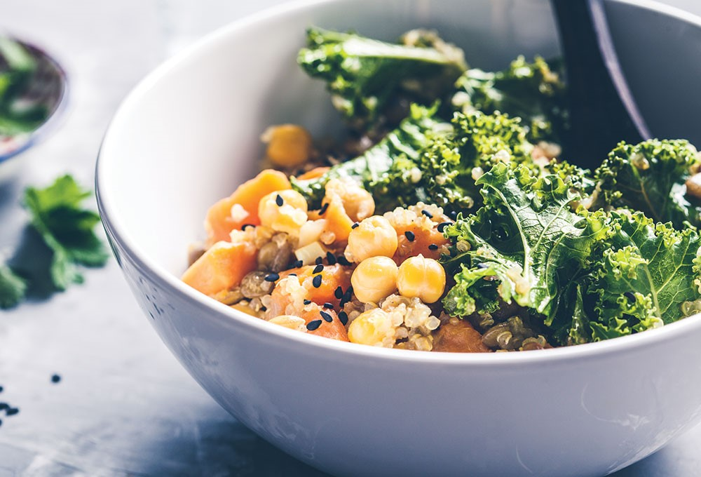 a bowl of broccoli and other food items