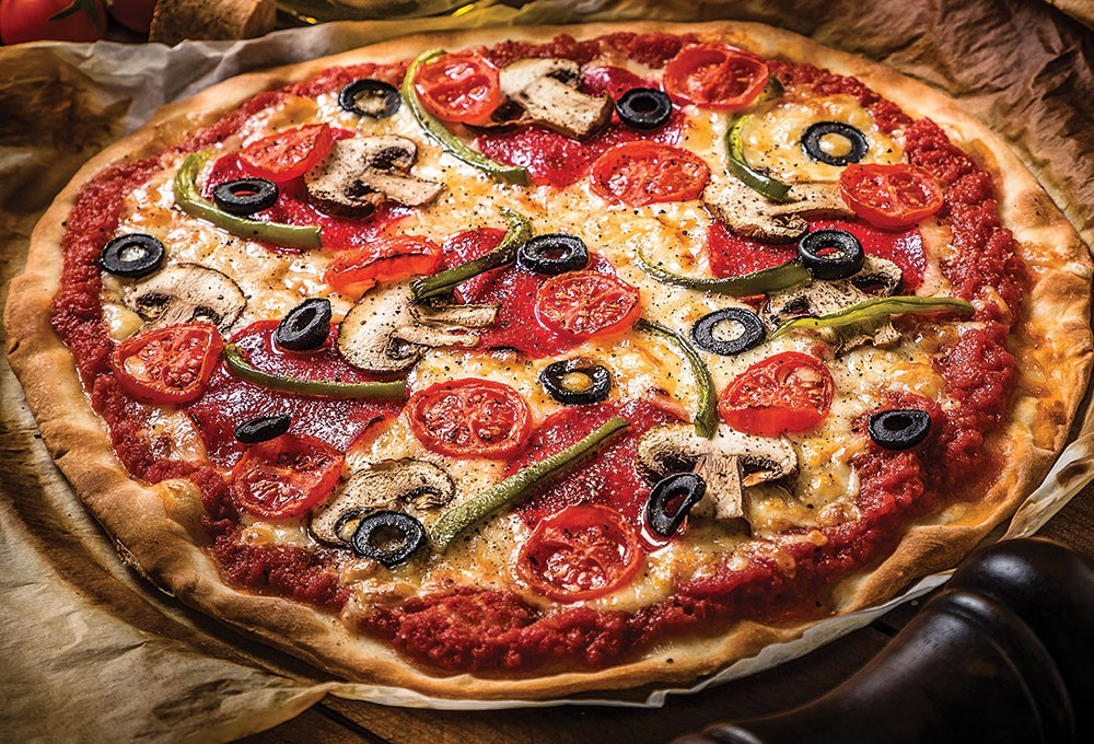 a pizza with tomatoes olives and olives