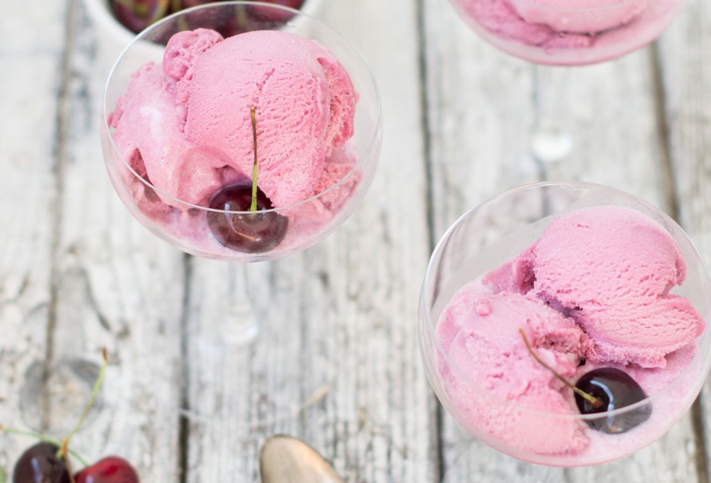 a couple of glasses with ice cream