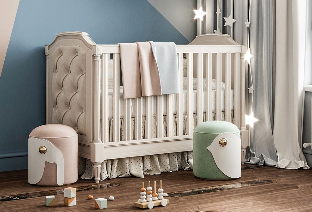 a white baby crib with white cloths and a white curtain