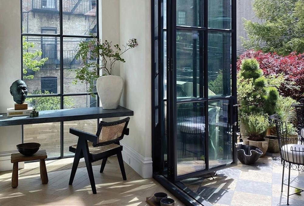 a room with a table and chairs