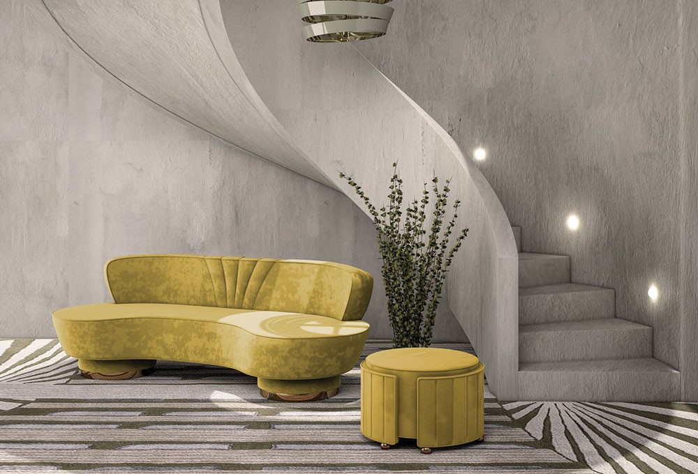 a yellow couch and a plant in a room with stairs