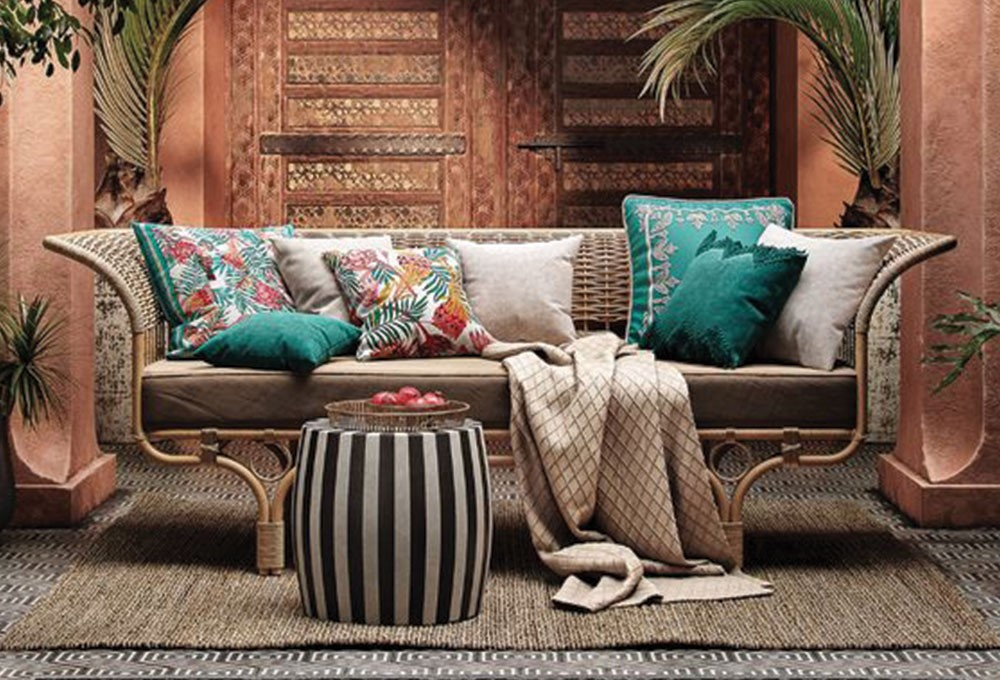 a couch with pillows and pillows