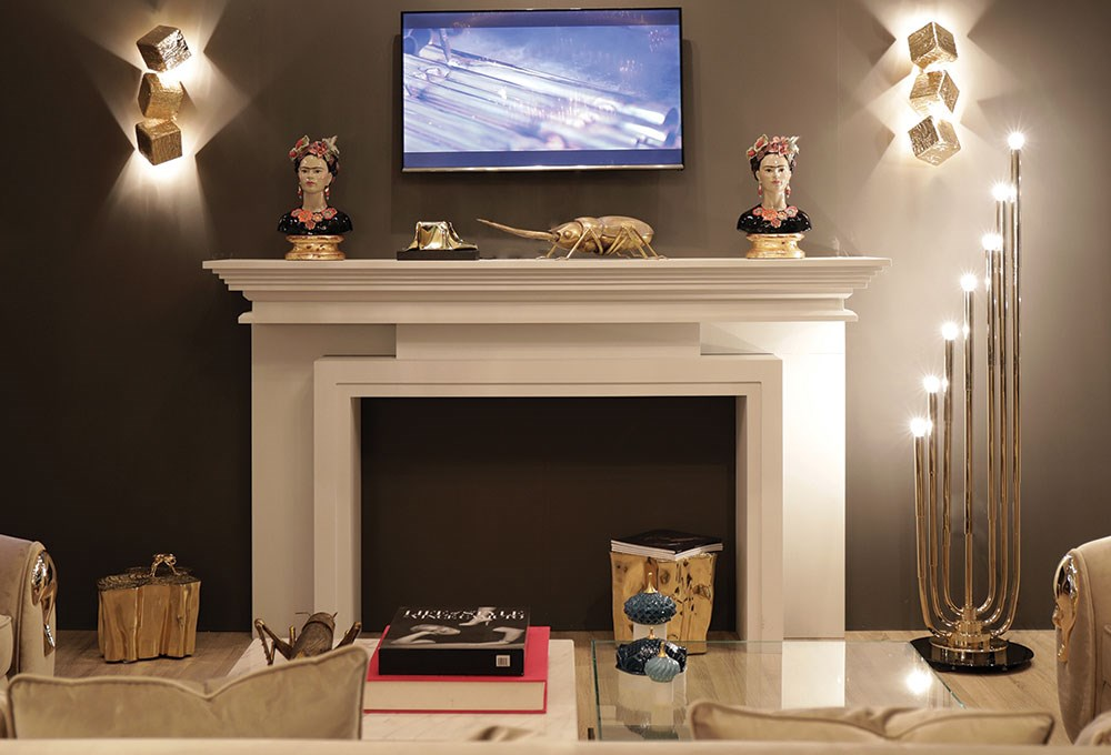 a fireplace with a tv and books